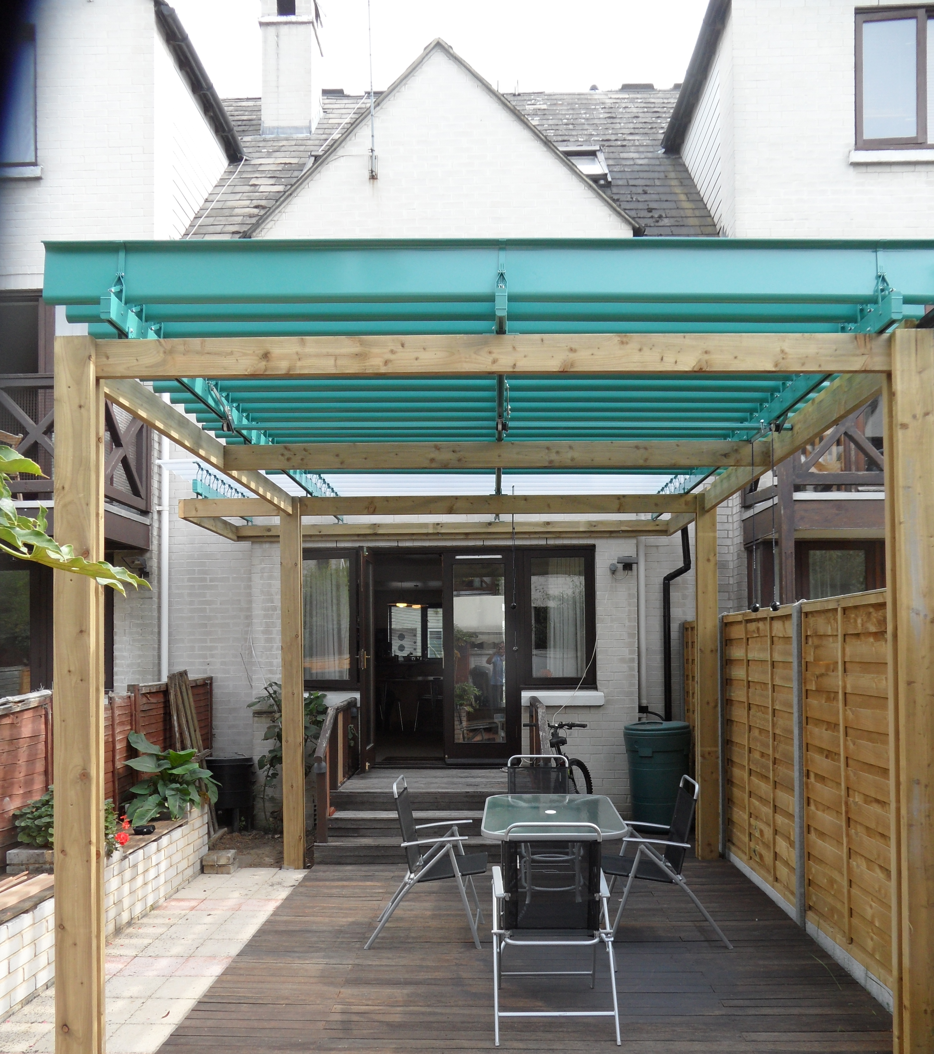 London Roofing Over Existing Deck Area To Provide Shade And